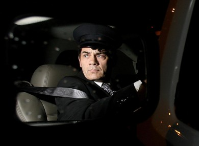 Hutch, pictured inside a limo, when he once operated a luxury car business