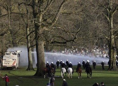 Police using a water cannon against crowds at a park in Brussels today.