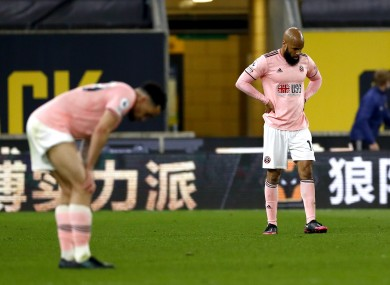 David McGoldrick is dejected as Sheffield United's return to the Championship is confirmed.