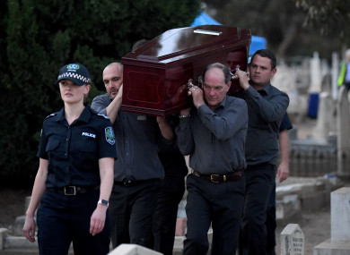 Adelaide Cemetery Authority pallbearers carry the body of the exhumed Somerton man.