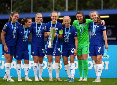 Chelsea players celebrate with the FA Women's Super League trophy.
