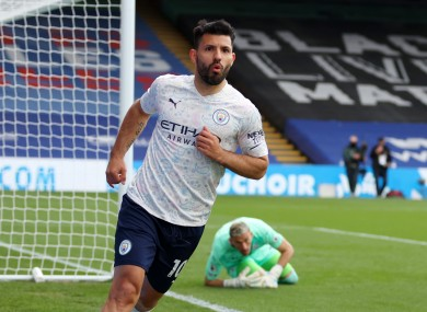 Sergio Aguero celebrates scoring Man City's first goal of the game.