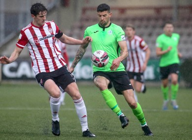 Derry City's Eoin Toal and Adam Foley of Finn Harps.
