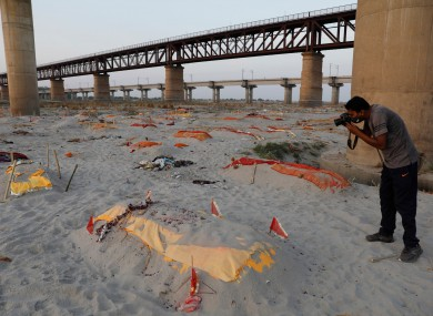 Bodies of suspected Covid-19 victims buried in shallow graves on the banks of Ganges in Prayagraj, India