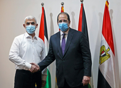 Yehiyeh Sinwar (left), the top Hamas leader in Gaza with the head of the Egyptian General Intelligence Abbas Kamel (right).