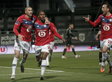 Burak Yilmaz, left, celebrates with Renato Sanches after scoring Lille's second goal.