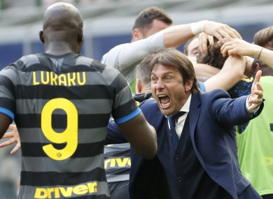 Antonio Conte celebrates with Romelu Lukaku after last week's win.