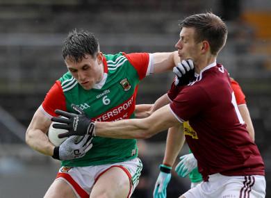 John Heslin tackles Mayo's Paddy Durcan.
