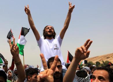 People celebrate the ceasefire between Israel and Hamas near the Al-Karama area in the Jordan Valley, Jordan, yesterday.
