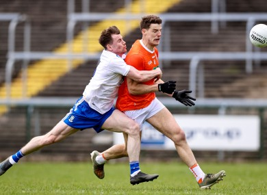 Monaghan's Karl O'Connell with Niall Grimley of Armagh.