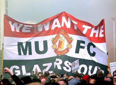 A banner held aloft during yesterday's protests at Old Trafford.