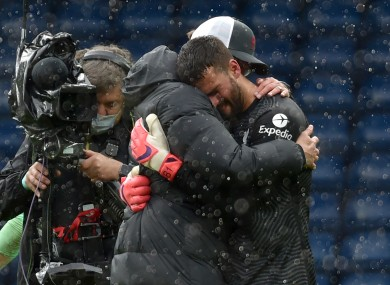 Alisson is embraced by Jurgen Klopp after the game.