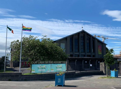 Irish and LGBT+ Pride flags outside the Ballyfermot Assumption Parish Church