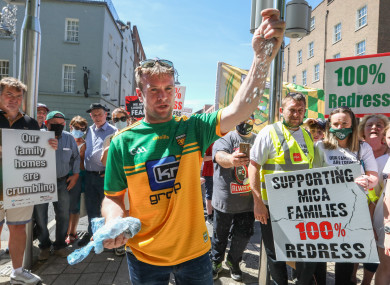 Paddy Diver, mica campaigner and co-founder of '100% Redress No Less', as he displays examples of the mica material at yesterday's protest.