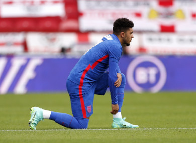 England's Jadon Sancho takes a knee before the friendly match at Riverside Stadium.