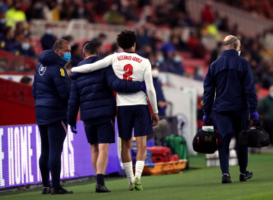 England's Trent Alexander-Arnold leaves the pitch after picking up an injury.