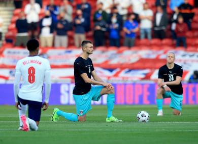 Austria's Sasa Kalajdzic takes the knee ahead of the International Friendly at The Riverside.