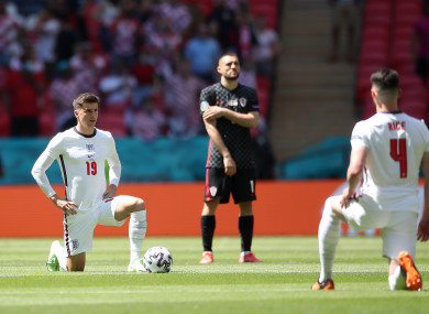 England's Mason Mount (left) and Declan Rice take the knee before the UEFA Euro 2020 Group D match.