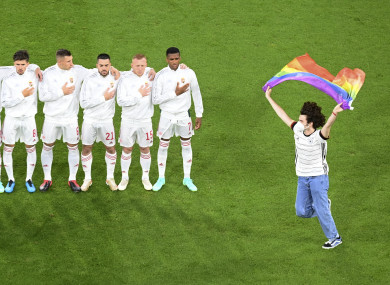A protestor holding a rainbow flag during last night's Euro 2020 match between Germany and Hungary.