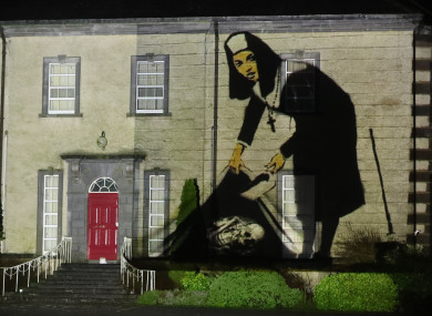 An image of a nun concealing a skeleton is projected onto Sean Ross Abbey in Roscrea in County Tipperary as part of the Herstory Light Show on St Brigid's Day.