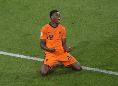 Netherlands player Denzel Dumfries celebrates.