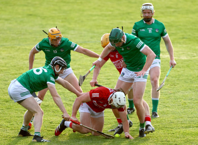 Limerick and Cork players battle for possession.