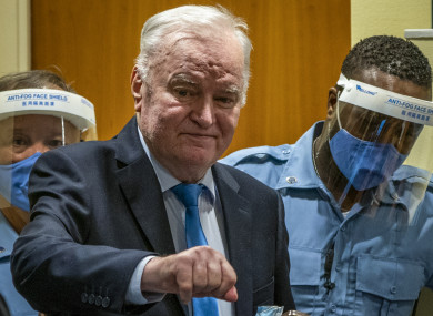 Former Bosnian Serb military chief Ratko Mladic enters the court room in The Hague, Netherlands