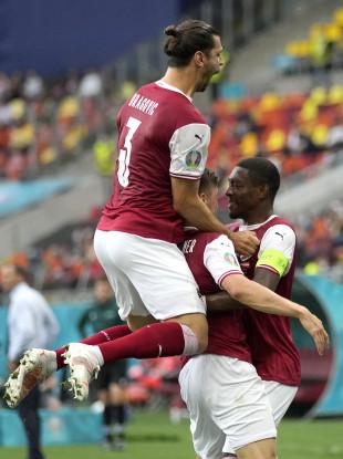 Austria's Christoph Baumgartner, centre, celebrates with team-mates David Alaba, right, and Aleksandar Dragovic after scoring.