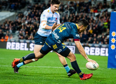 Sio Tomkinson runs in one of the Highlanders' nine tries.