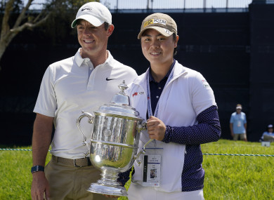 2021 US Women's Open golf champion Yuka Saso, of the Philippines, poses with Rory McIlroy.