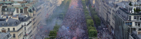 Alternative view: People celebrate on the Champs Elysees avenue after the final of the 2018 World Cup - 15 July 2018