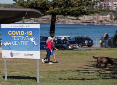 A couple walking their dog near a Covid-19 testing centre in Sydney, Australia