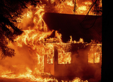 : Flames consume a home as the Dixie Fire tears through the Indian Falls community in Plumas County, California.