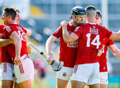 Cork players celebrate their victory.