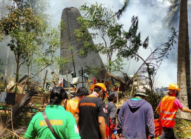 Rescuers search for survivors at the crash site.