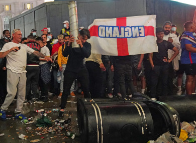 Football fans in Piccadilly Circus, London, after Italy beat England on penalties to win the UEFA Euro 2020 Final.