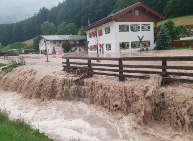 Water flows over a square in front of a house in Bavaria