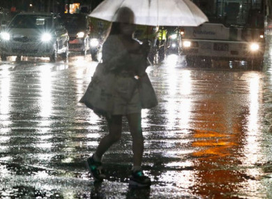 A woman makes her way through heavy rain in Fukuoka, western Japan