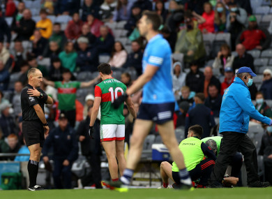 Conor Lane indicates a shoulder tackle as Eoghan McLaughlin lies injured.