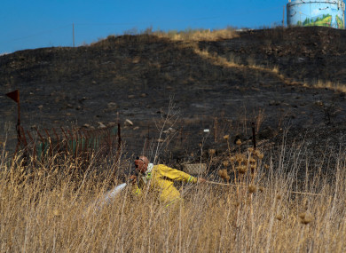 Fields burn following a hit by a rocket fired from Lebanon into Israeli territory, near the northern Israeli town of Kiryat Shmona.