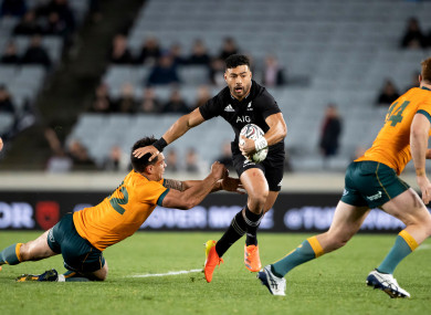 All Blacks' Richie Mo'unga tries to evade a tackle.