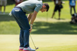 Rory McIlroy reacts to a missed putt.