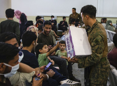 US marine hands out water to evacuees at Hamid Karzai International Airport in Kabul.
