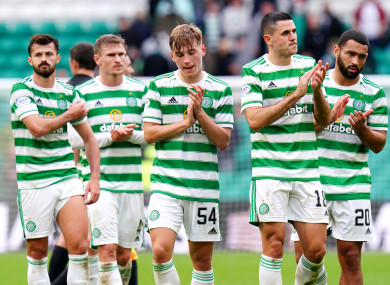 Celtic players applaud supporters at the end of the draw with Dundee United.