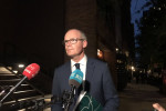 Minister Simon Coveney speaking to the Irish media before heading off to Washington DC.