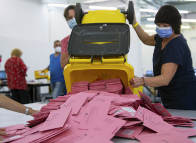 Election workers prepare to count absentee ballots in Munich today.