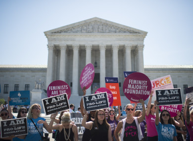 Pro-choice and pro-life demonstrators rally outside of the US Supreme Court. 2016.