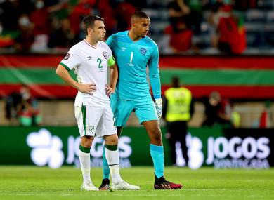 Ireland's Seamus Coleman and Gavin Bazunu dejected after the game.
