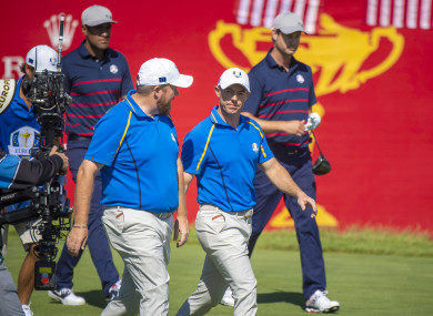 Lowry and McIlroy pictured during Friday's play.