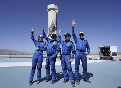 Blue Origin's New Shepard rocket latest space passengers from left, Audrey Powers, William Shatner, Chris Boshuizen, and Glen de Vries raise their hands during a media availability at the spaceport near Van Horn, Texas